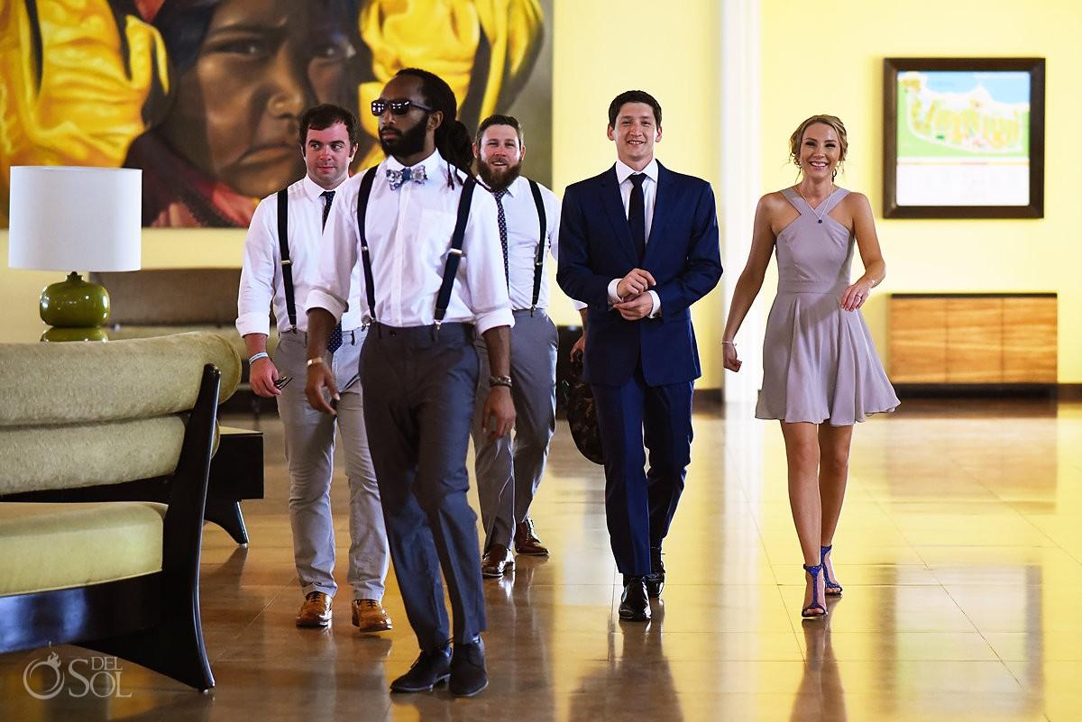 bridal party walking to wedding ceremony Barceló Maya Palace Riviera Maya Mexico
