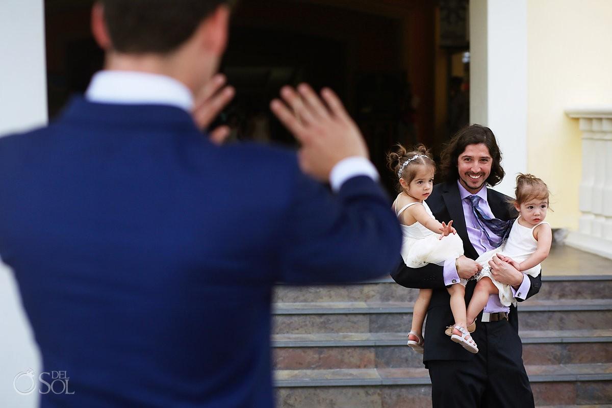 funny wedding photo groom waving at children in wedding entrance Barceló Maya Palace Riviera Maya Mexico