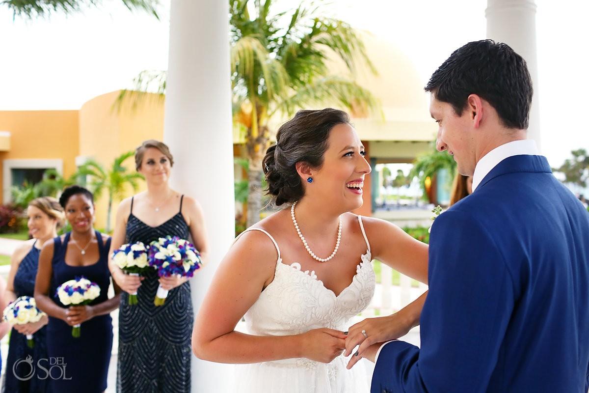 funny wedding photo bride pretends wedding ring is stuck Barceló Maya Palace Riviera Maya Mexico