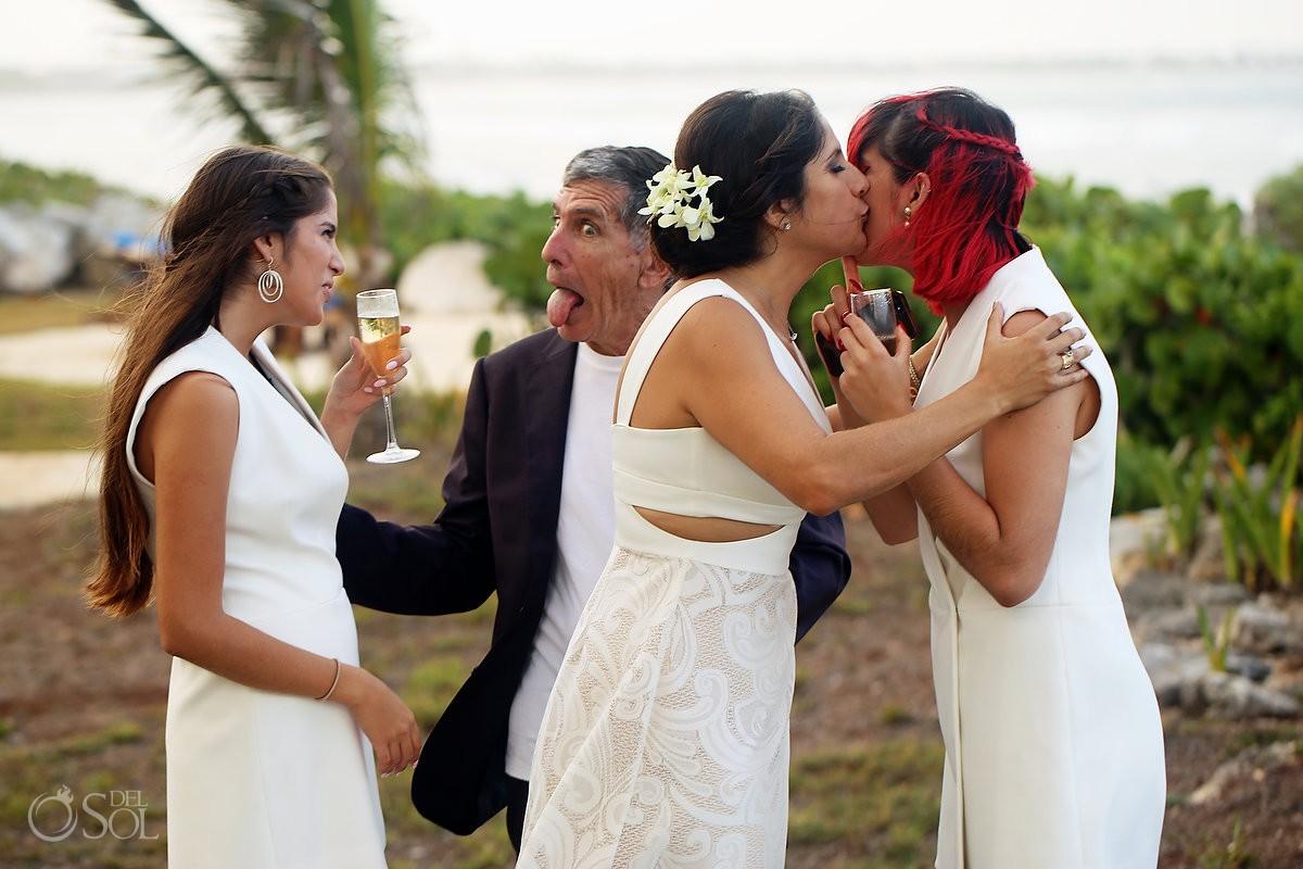 Bride and groom hugs wedding ceremony Akumal Punta Sur Riviera Maya Mexico
