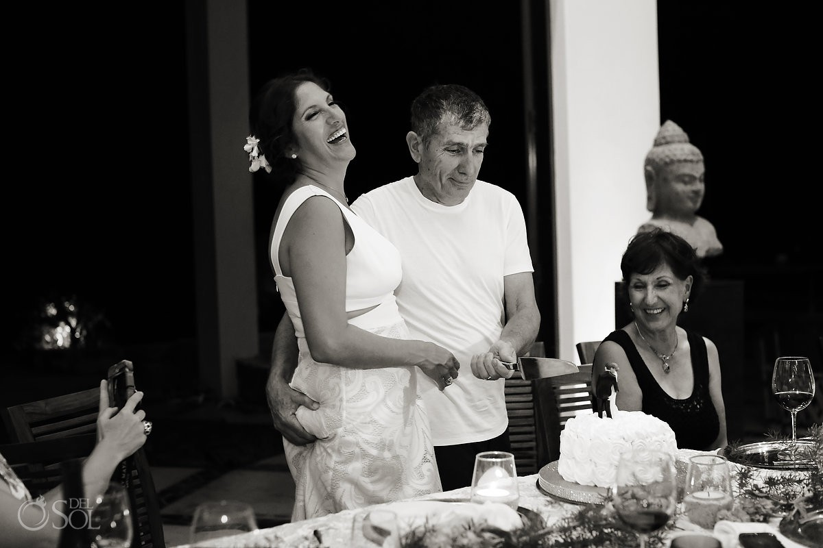 Bride and groom wedding cake cutting Akumal Punta Sur Riviera Maya Mexico