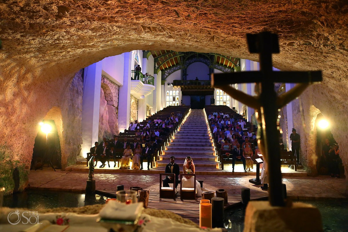 Xcaret Park Wedding ceremony inside the Capilla de Guadalupe an awe-inspiring Catholic Chapel in Playa del Carmen Mexico.