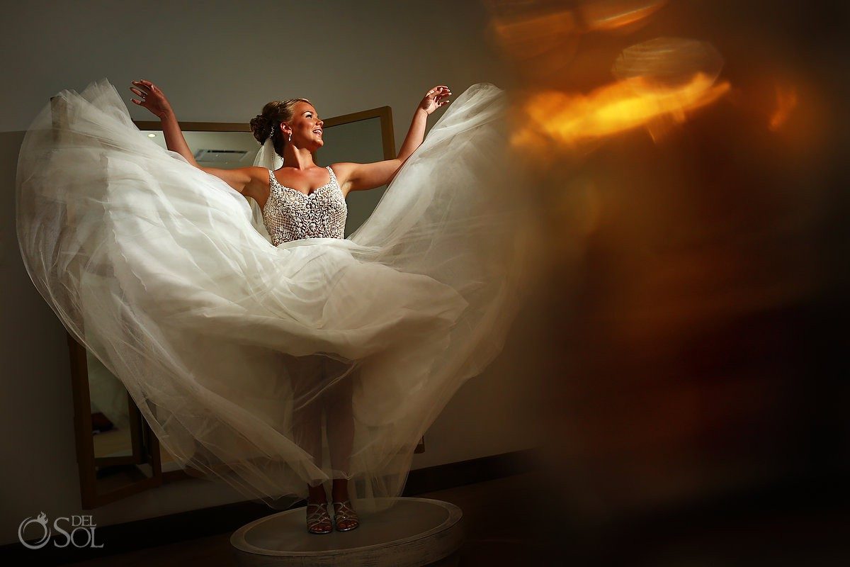 creative bride portrait throwing her dress Breathless Riviera Cancun Wedding Mexico