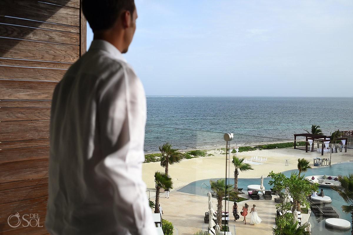 groom watrches bride walk towards wedding ceremony set up Breathless Riviera Cancun Wedding Mexico