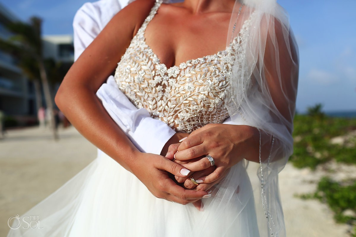bride and groom holding hands detail with engagement ring Breathless Riviera Cancun Wedding Mexico