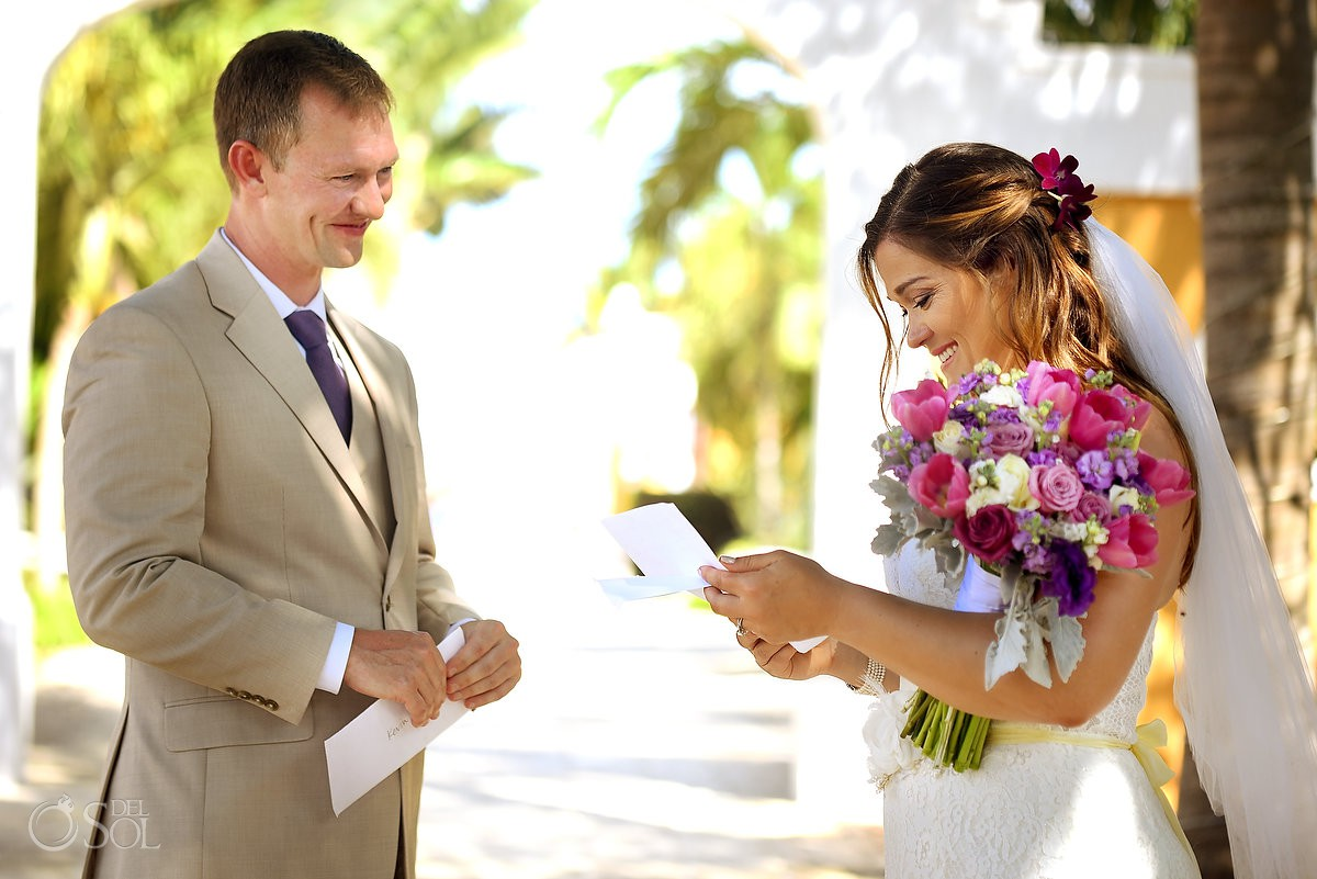 bride reading note from groom, first look Dreams Tulum Beach Wedding
