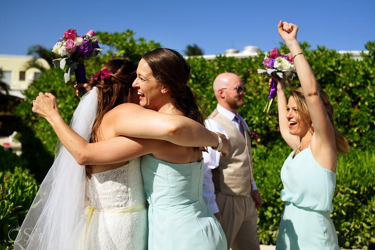 celebration and hugs after wedding ceremony Dreams Tulum Beach Wedding