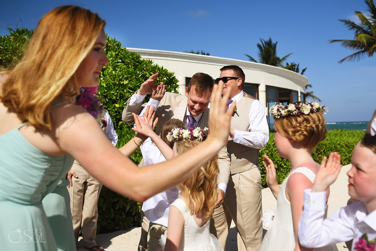 high fives celebration after ceremony Dreams Tulum Beach Wedding