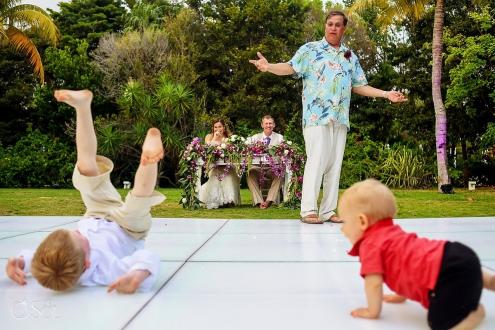 funny wedding photo kids playing on the dance floor destination wedding reception Dreams Tulum garden
