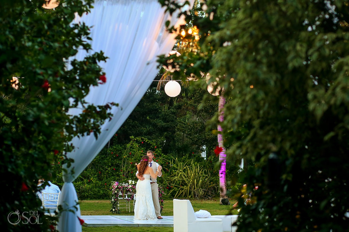 Bride and groom first dance destination wedding reception Dreams Tulum garden