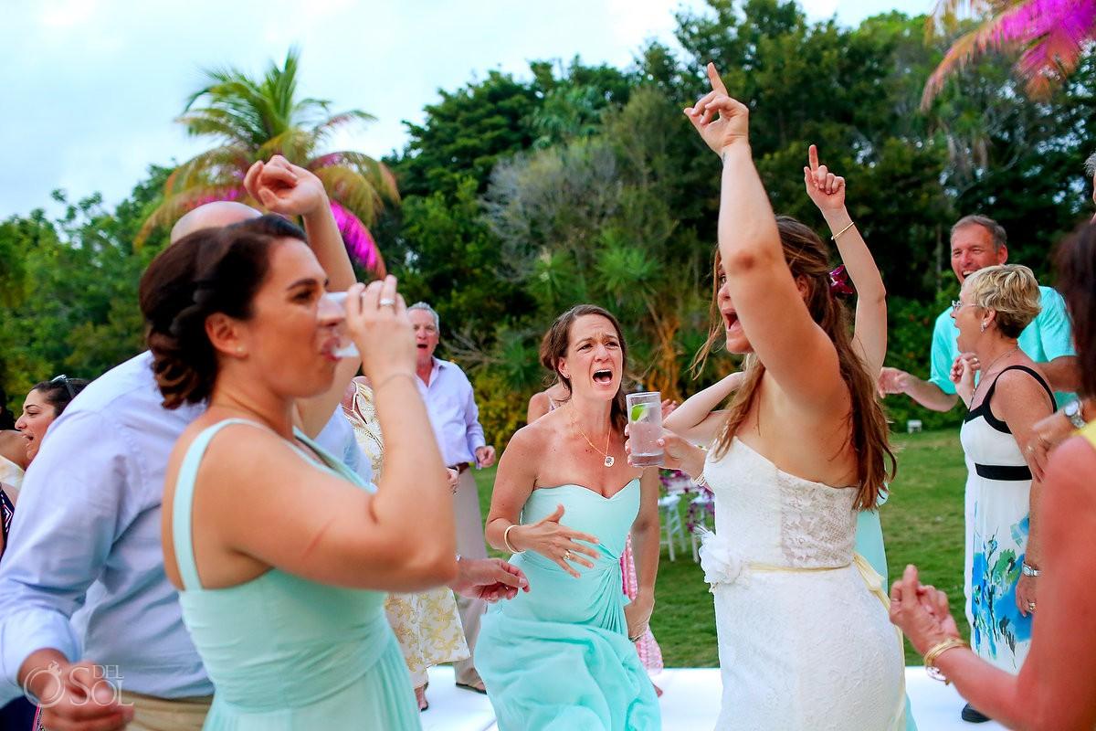 bride and bridesmaids having fun on the dance floor destination wedding reception Dreams Tulum garden