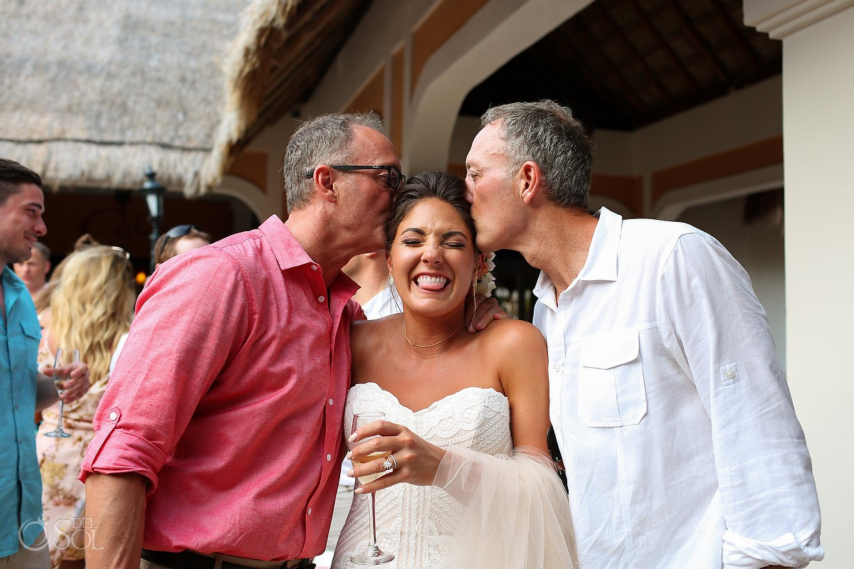 parents kissing bride Wedding Now Sapphire Riviera Cancun Riviera Maya Mexico