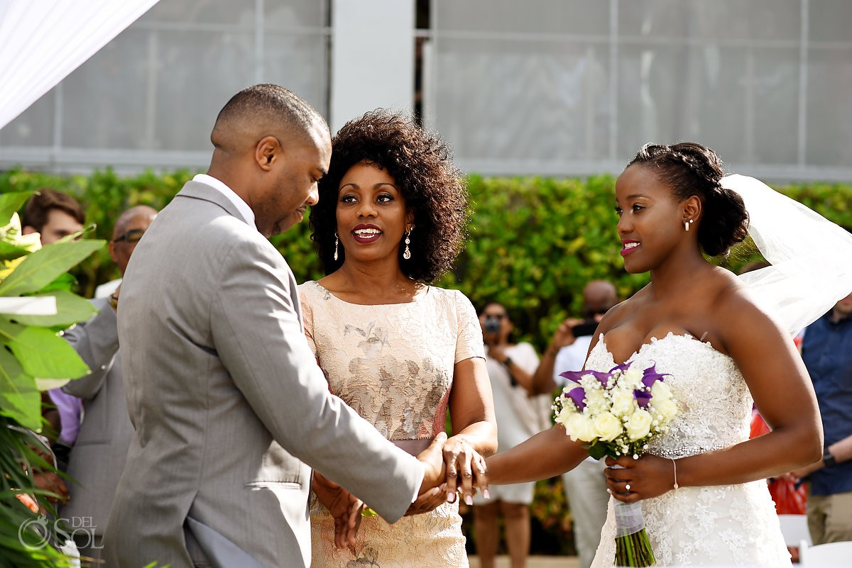 mother of bride gives bride away garden Destination Wedding ceremony Riu Palace Peninsula Cancun Mexico