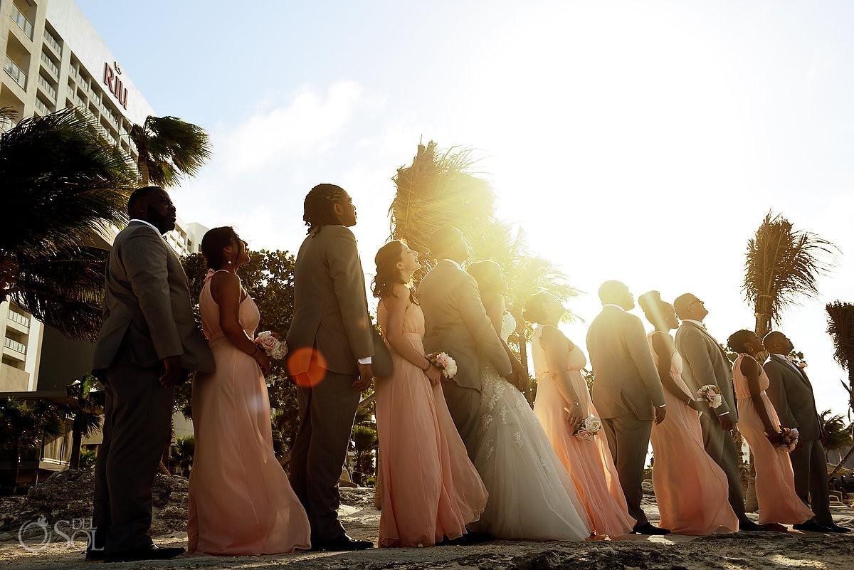 golden hour sunset flare bridal party portrait Destination Wedding Riu Palace Peninsula Cancun Mexico