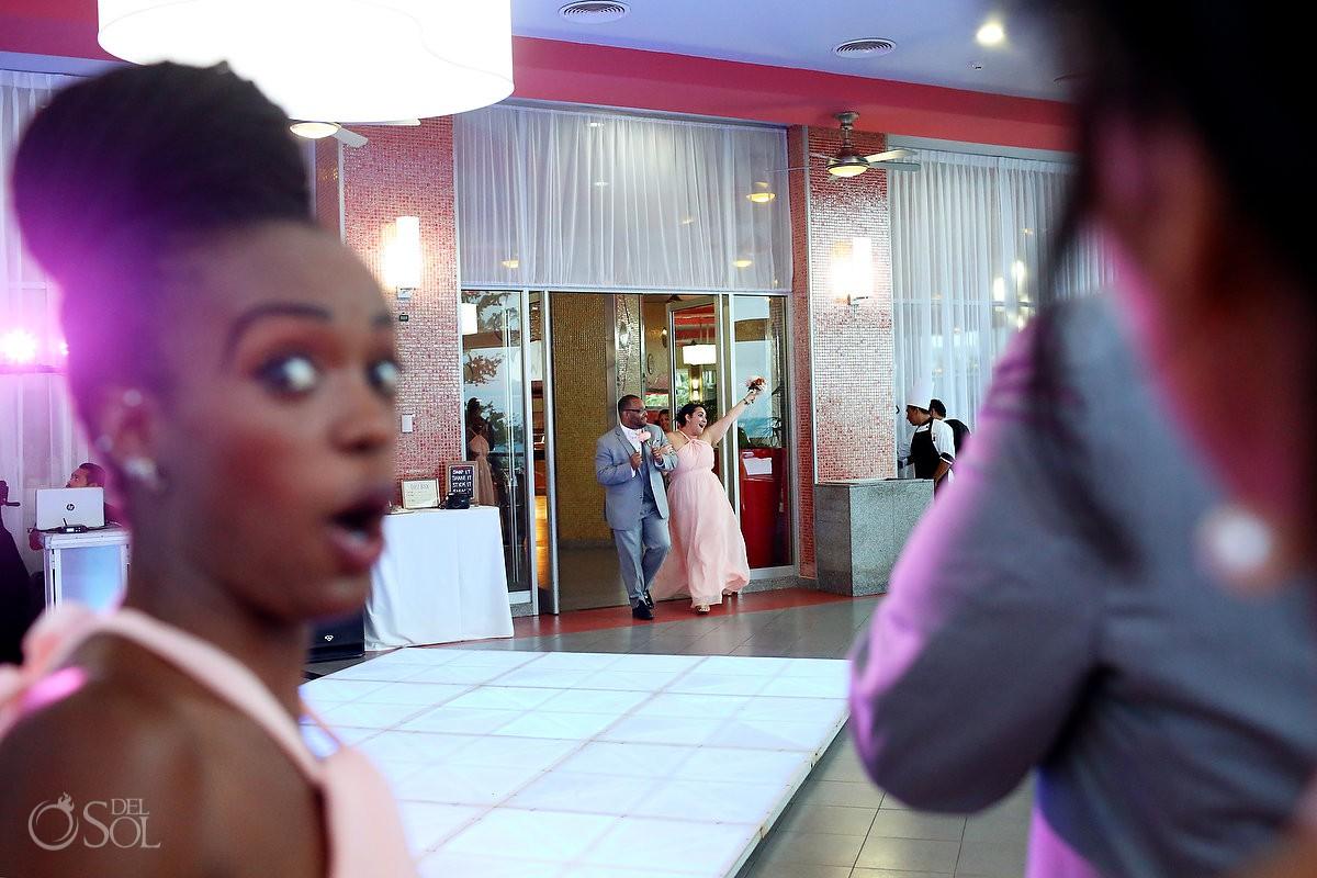 funny wedding photo bridesmaid entrance glass box restaurant Destination Wedding reception Riu Palace Peninsula Cancun Mexico