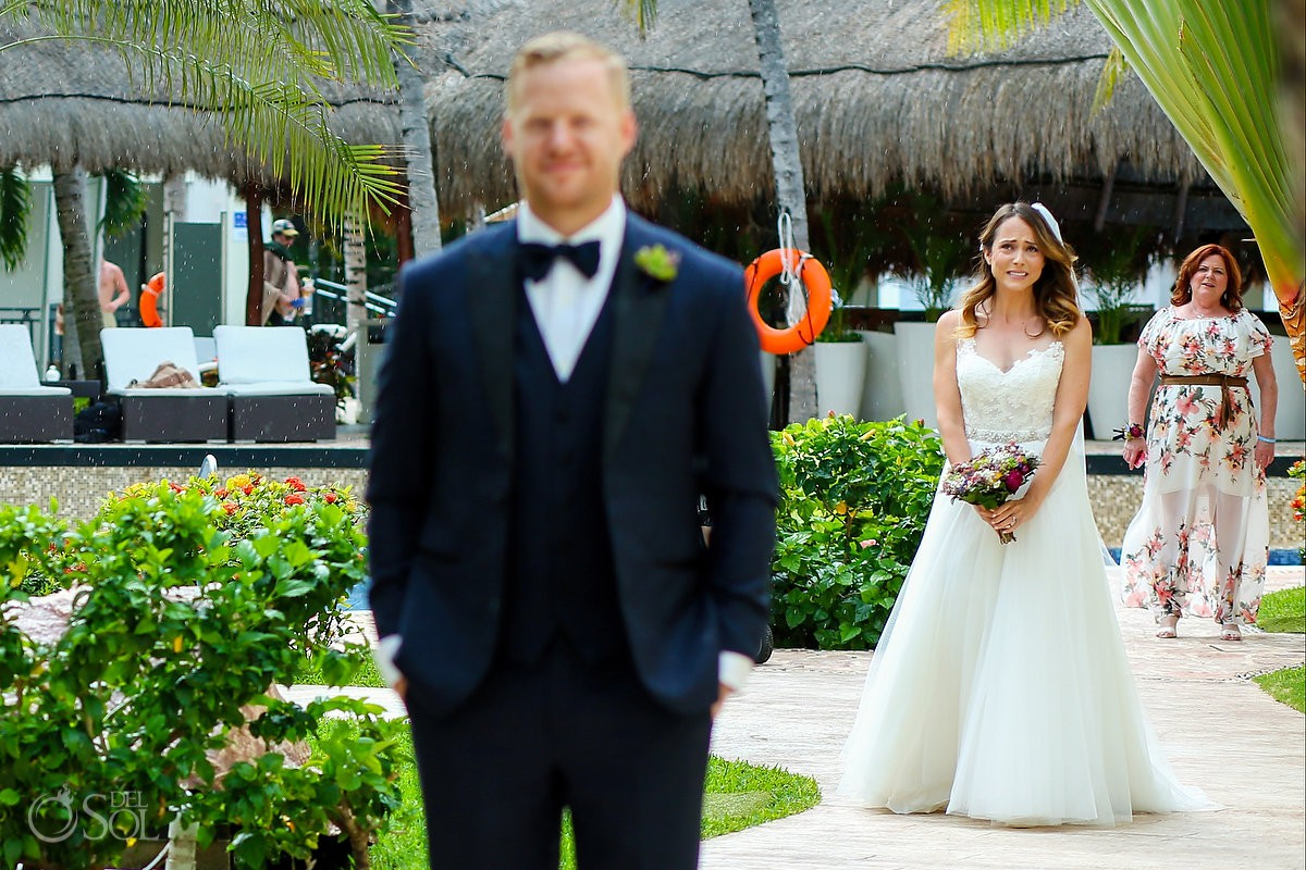 Love under rain bride and groom first look Azul Beach Hotel by Karisma, Puerto Morelos, Mexico
