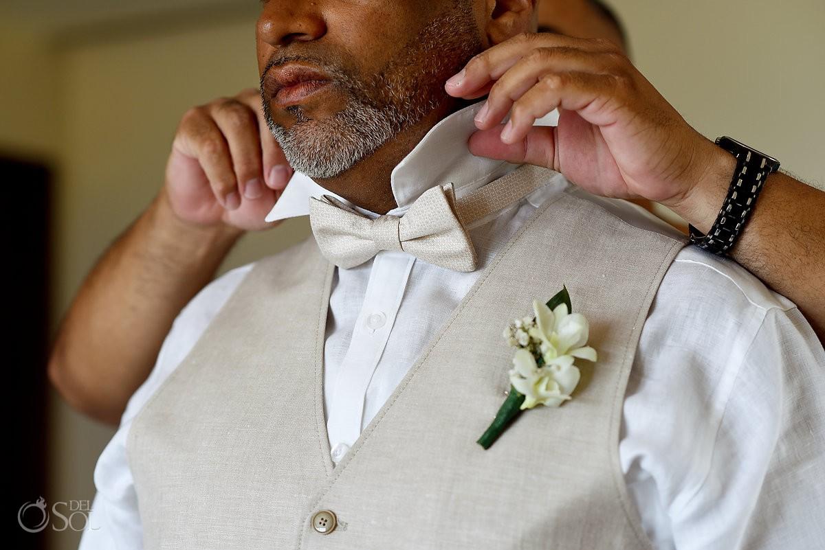 groom wearing beige vest and cream silk bow tie detail Now Jade Riviera Cancun Puerto Morelos Destination wedding