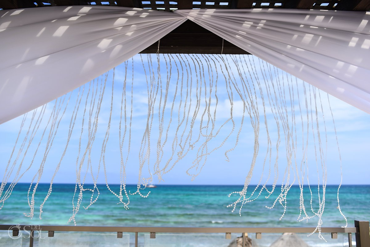 wedding gazebo detail flying in the wind in front of the Caribbean Ocean Now Jade Riviera Cancun Puerto Morelos Destination wedding