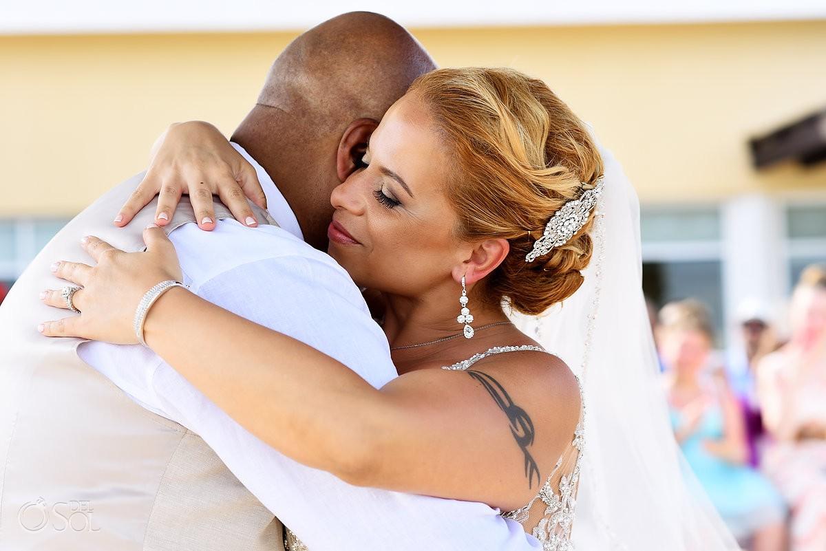 bride hugs groom Now Jade Riviera Cancun Puerto Morelos Destination wedding
