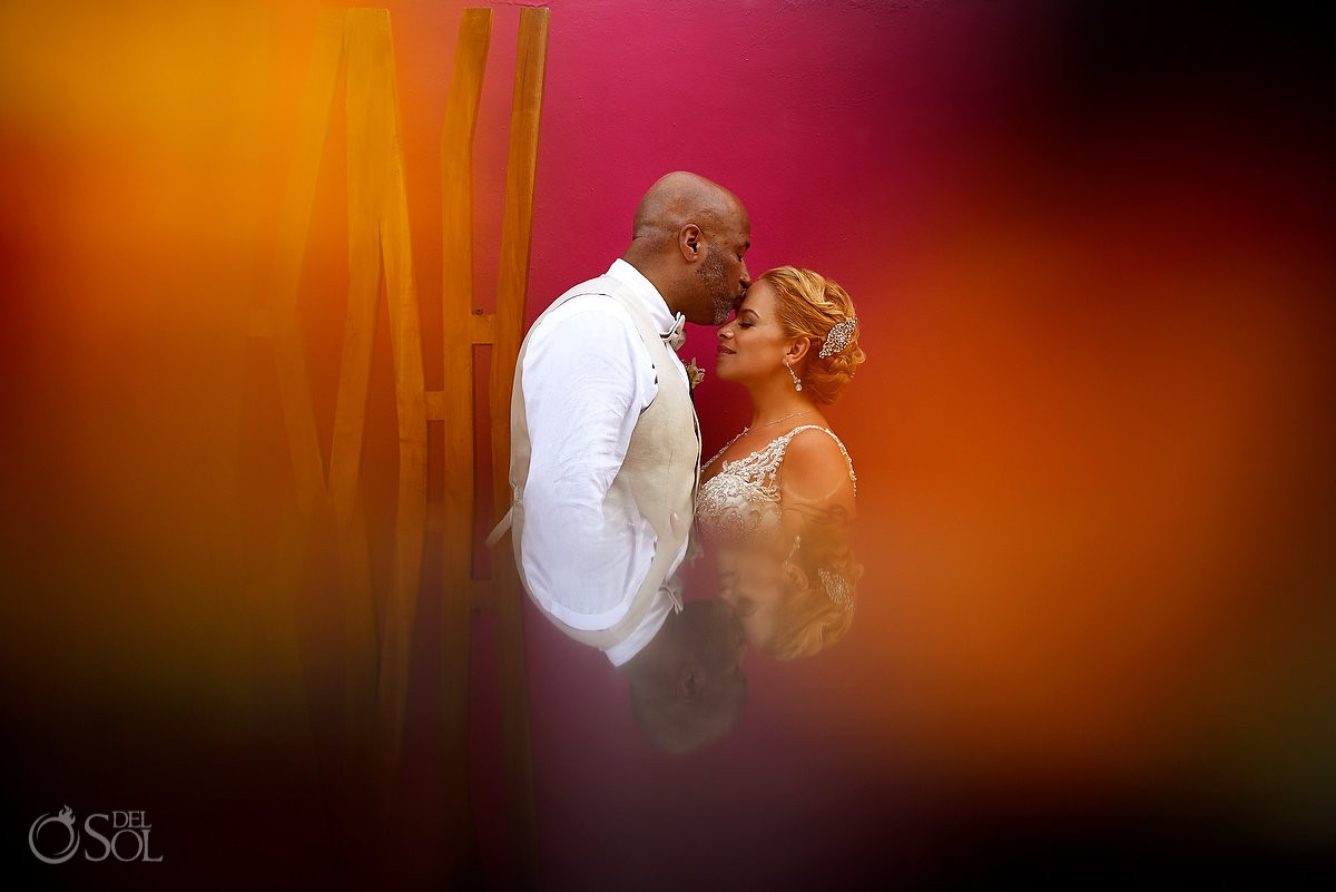 bride and groom reflection portrait against bright color pink wall Now Jade Riviera Cancun Puerto Morelos Destination wedding