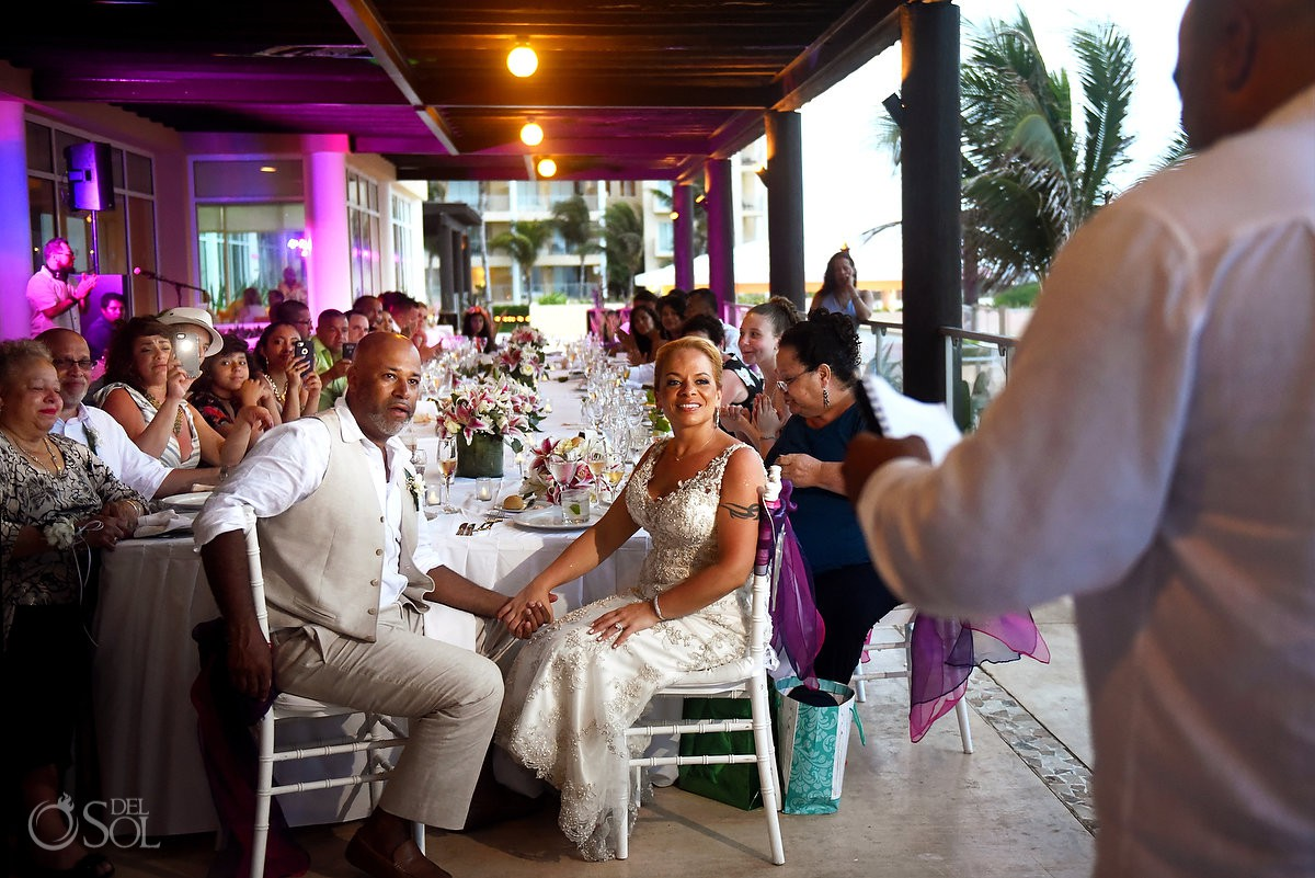 bride and groom watch speeches Now Jade Riviera Cancun Puerto Morelos Destination wedding reception Mexico