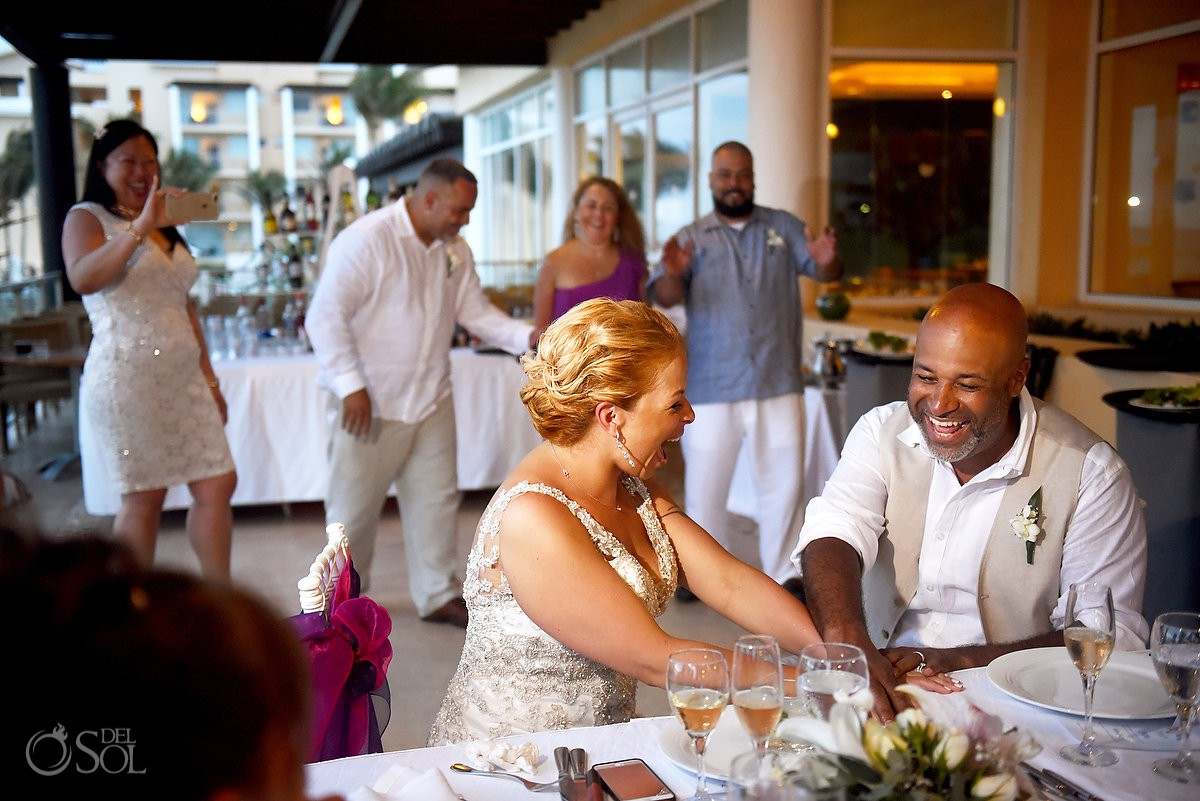 bride and groom laugh during speeches Now Jade Riviera Cancun Puerto Morelos Destination wedding reception Mexico