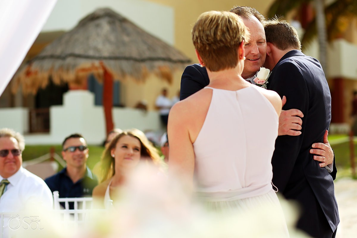 father of groom hugs groom family love destination wedding Now Sapphire Riviera Cancun Mexico