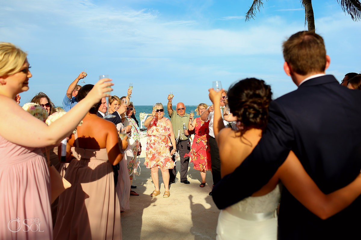 wedding guests toast newlyweds beach wedding Now Sapphire Riviera Cancun Mexico