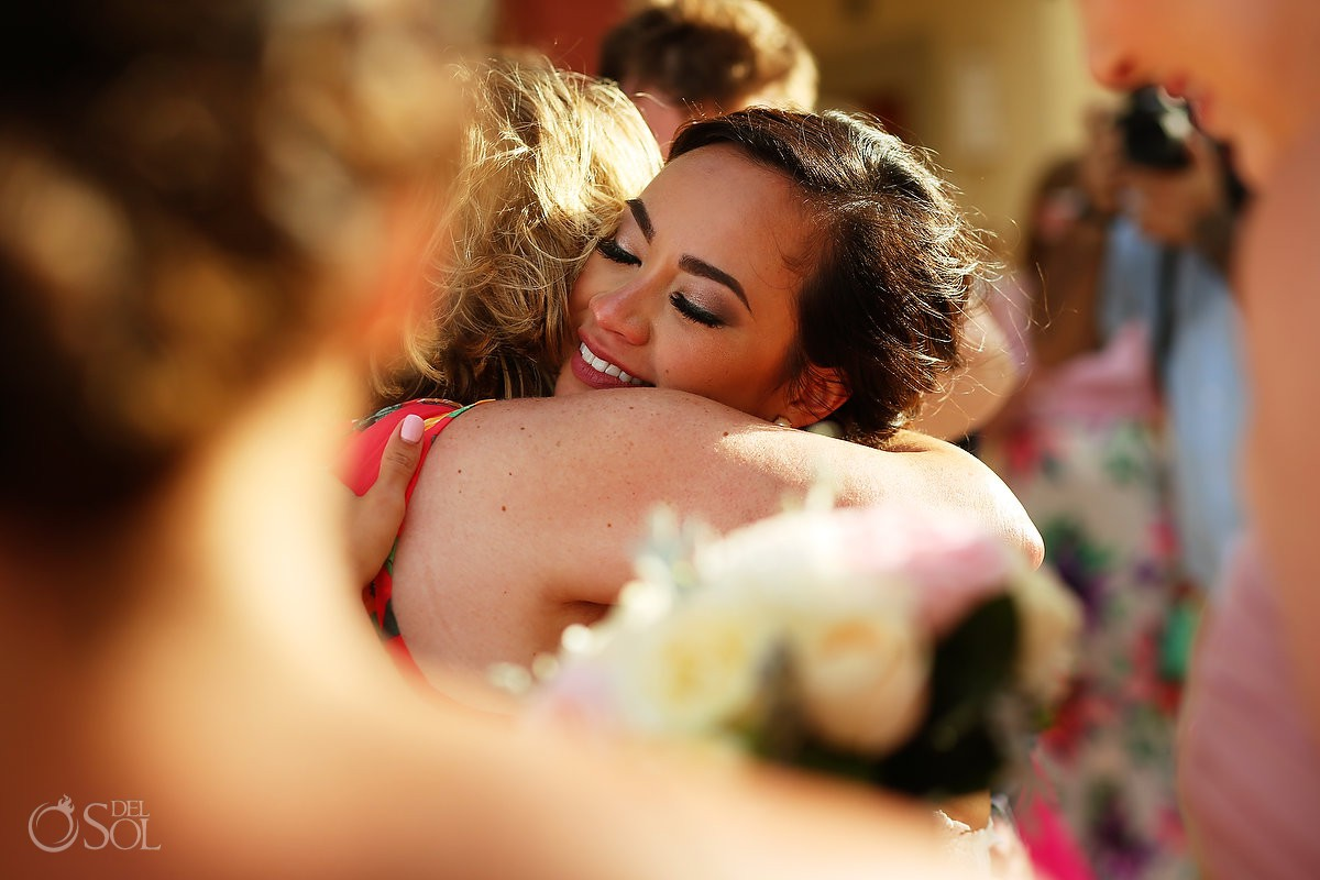 hugs and celebration after ceremony beach wedding Now Sapphire Riviera Cancun Mexico
