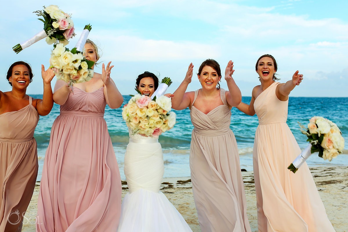 fun bridal party bride and bridesmaids idea throwing bouquets beach wedding Now Sapphire Riviera Cancun Mexico