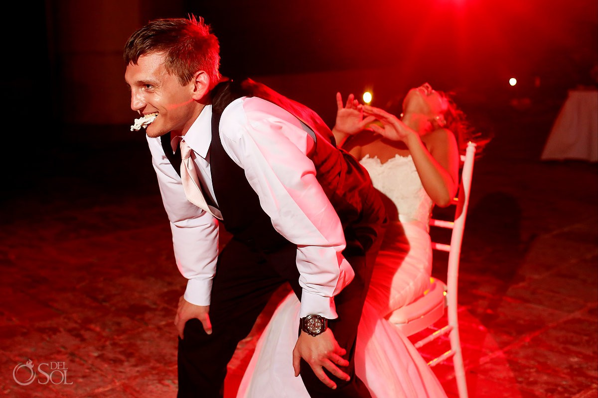 groom lap dances bride with garter in his mouth destination wedding reception Now Sapphire Riviera Cancun Mexico