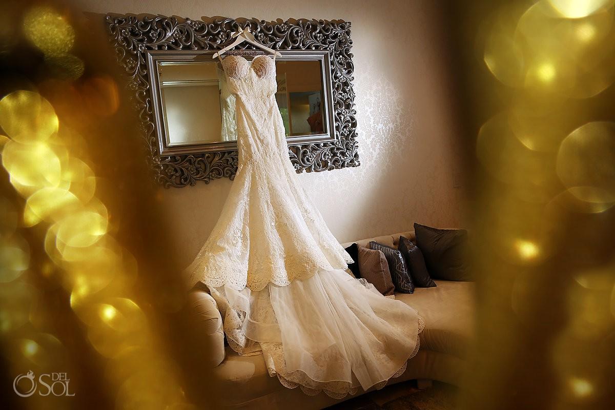 lace wedding dress hanging in Paradisus Playa del Carmen Bridal suite