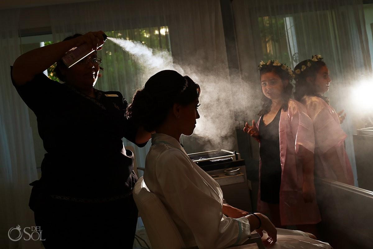 artistic silhouette of bride getting ready having her hair sprayed Paradisus Playa del Carmen La Perla Mexico