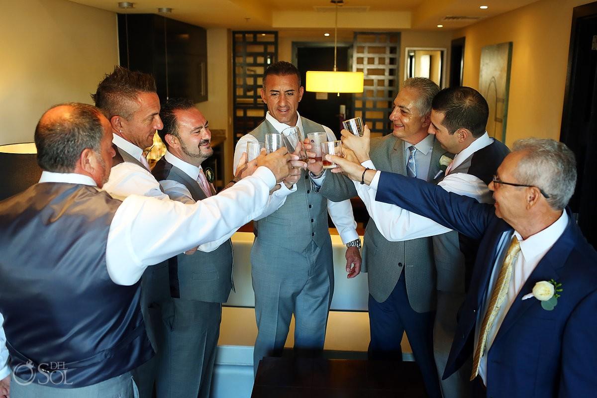 destination wedding Groom getting ready toasting with friends Paradisus Playa del Carmen La Perla Mexico