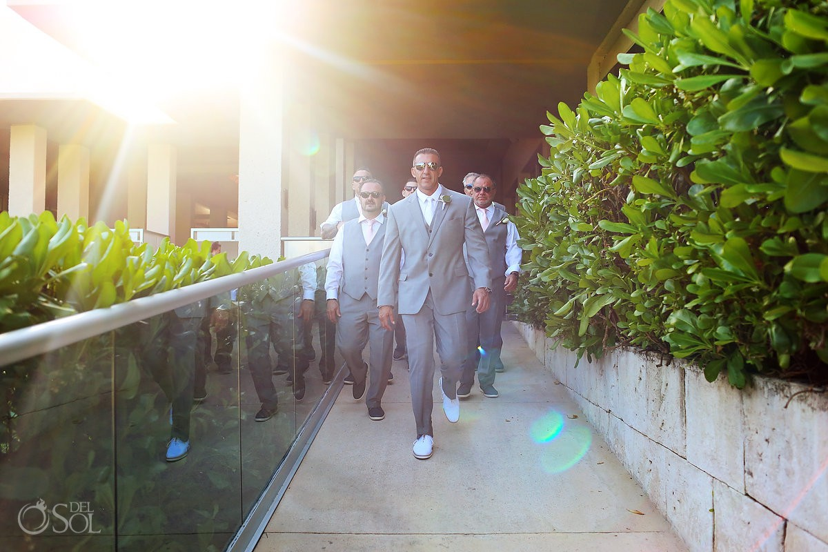 groom and groomsmen walking to destination wedding Ceremony Gabi Bridge Paradisus Playa del Carmen La Perla Mexico