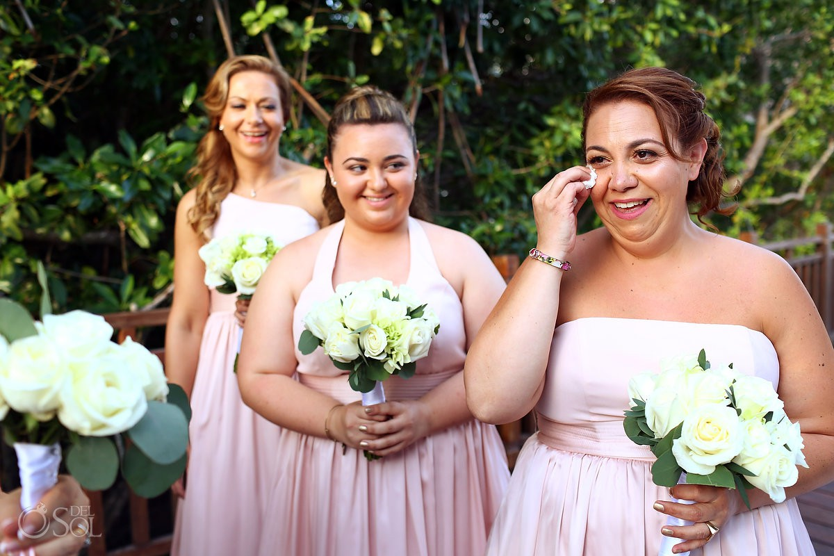bridesmaid crying wearing pink strapless dress holding cream bouquet Paradisus Playa del Carmen La Perla Mexico