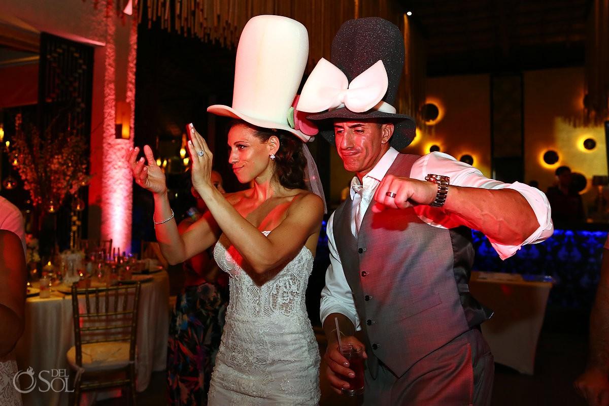 bride and groom wearing fun foam hats destination wedding Reception Gabi club Paradisus Playa del Carmen La Perla Mexico