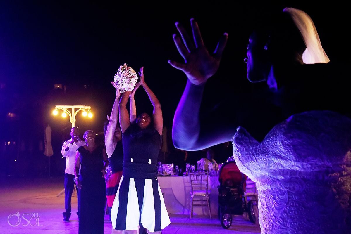 bride throwing bouquet Dreams Riviera Cancun Resort, Mexico
