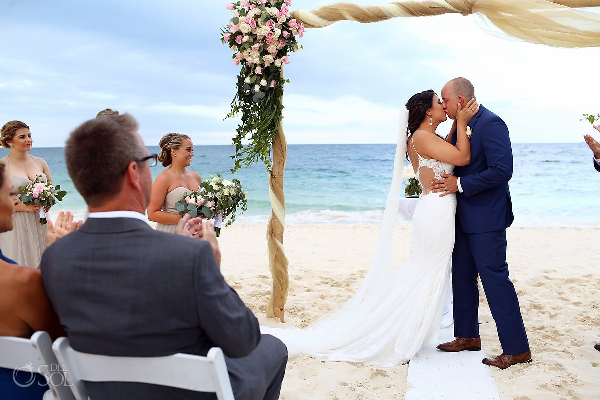 first kiss beach destination wedding ceremony Secrets Playa Mujeres Golf and Spa Resort