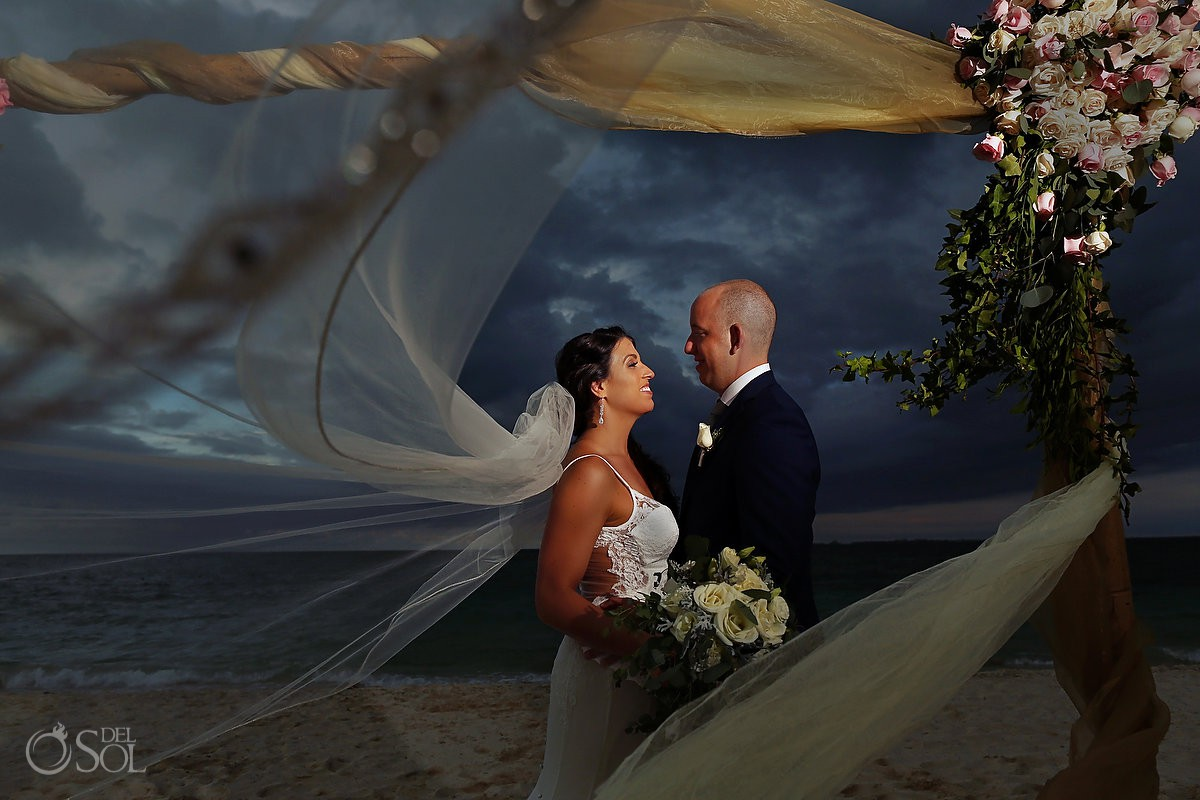 dramatic storm skies destination wedding bride and groom portrait with cathedral veil Secrets Playa Mujeres Golf and Spa Resort