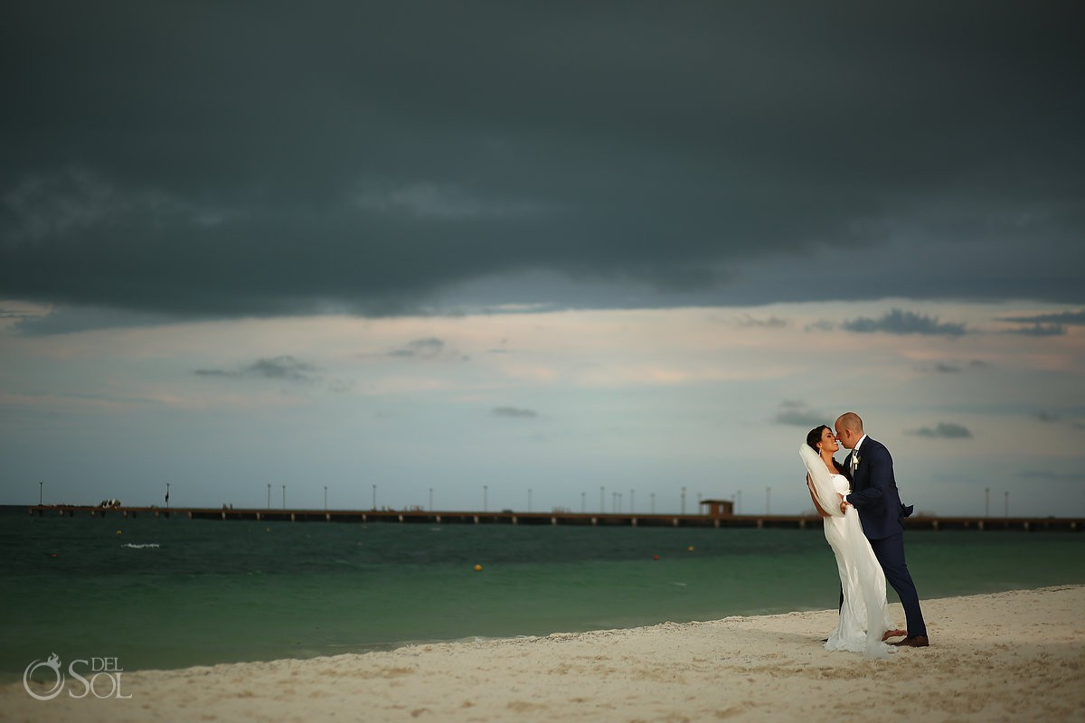 destination wedding bride and groom portrait Rain clouds Secrets Playa Mujeres Golf and Spa Resort