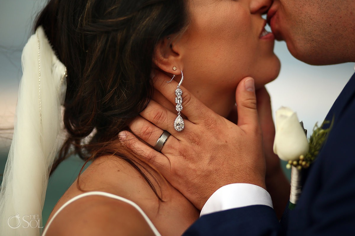 destination wedding bride and groom portrait Detail hands earrings Secrets Playa Mujeres Golf and Spa Resort