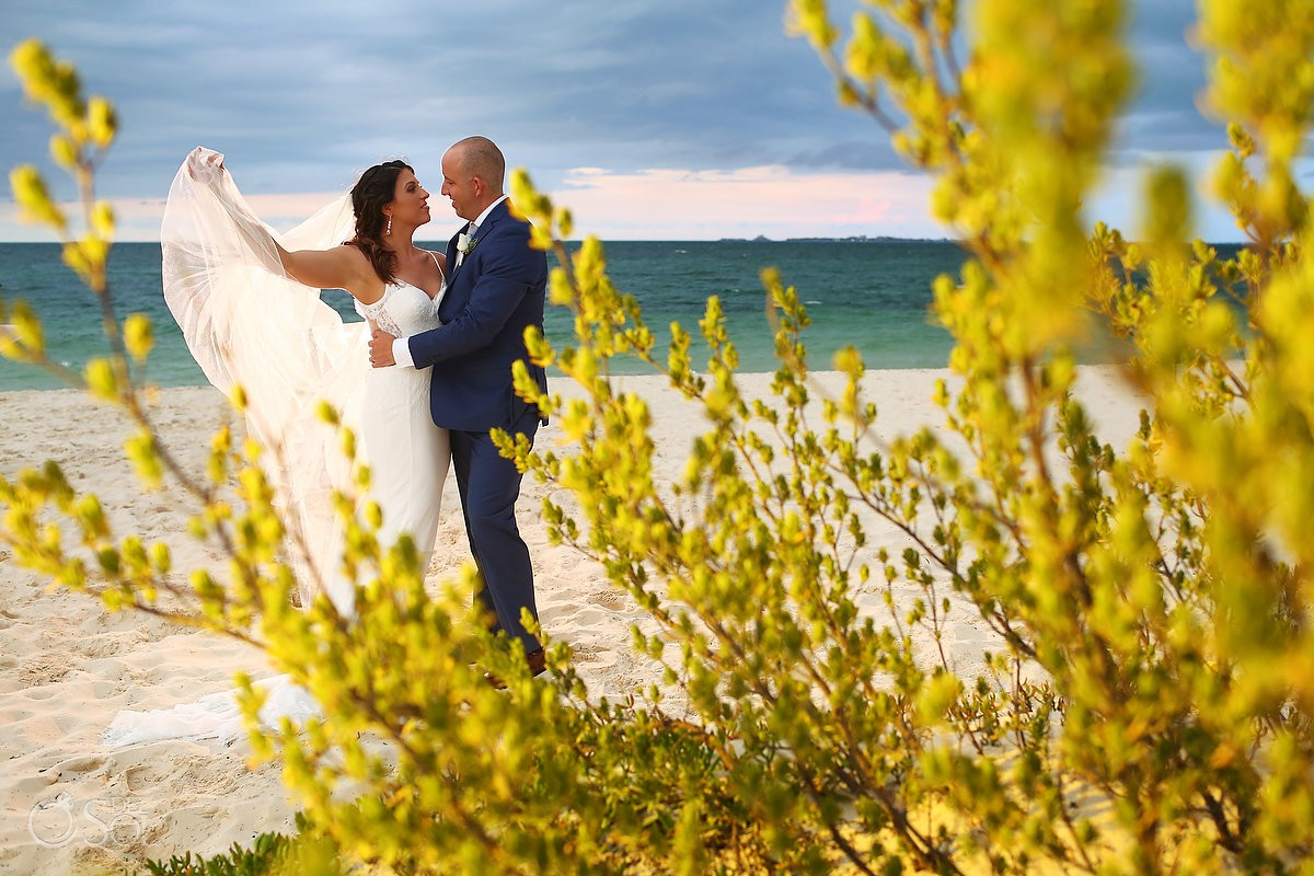 destination wedding bride and groom portrait Secrets Playa Mujeres Golf and Spa Resort beach