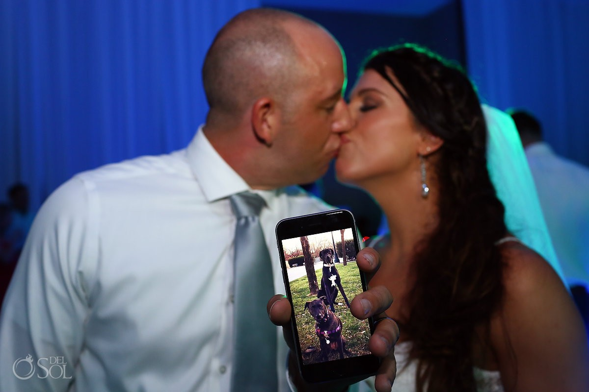 cute wedding photo idea for dog lovers photo of dogs on iphone couple kiss Secrets Playa Mujeres Golf and Spa Resort