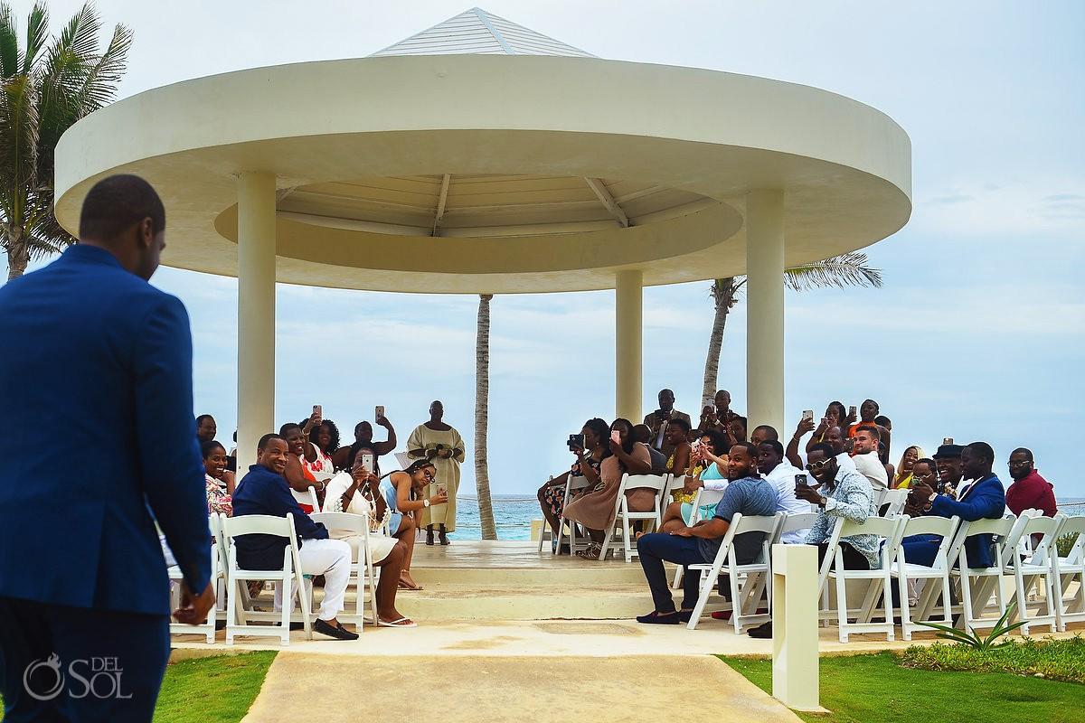 groom arrives to cliff side gazebo destination wedding ceremony Hyatt Ziva Cancun Mexico