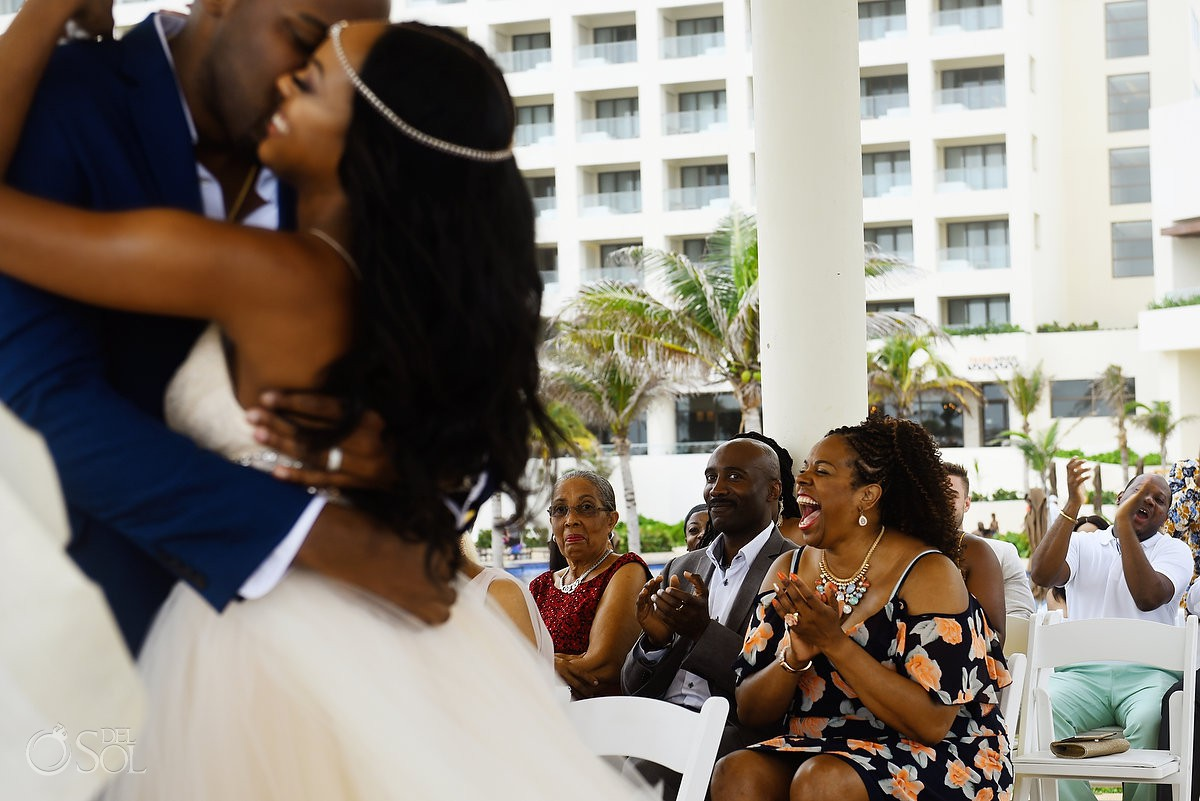 guest cheers first kiss cliff side gazebo destination wedding ceremony Hyatt Ziva Cancun Mexico