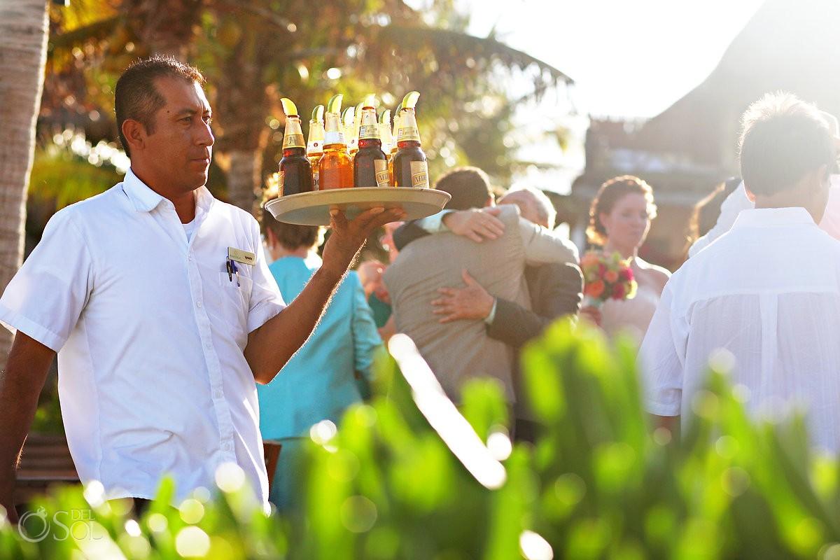 cocktail hour waiter serving cold beers destination wedding venue Mahekal Beach Resort Playa del Carmen