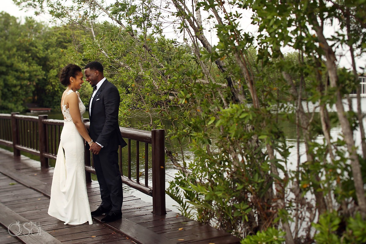 first look on bridge of Banyan Tree Mayakoba Wedding Playa del Carmen Mexico