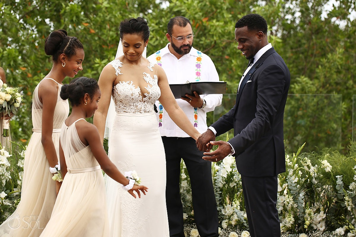 bride and groom welcome grooms daughters into the ceremony Banyan Tree Mayakoba Wedding Playa del Carmen Mexico