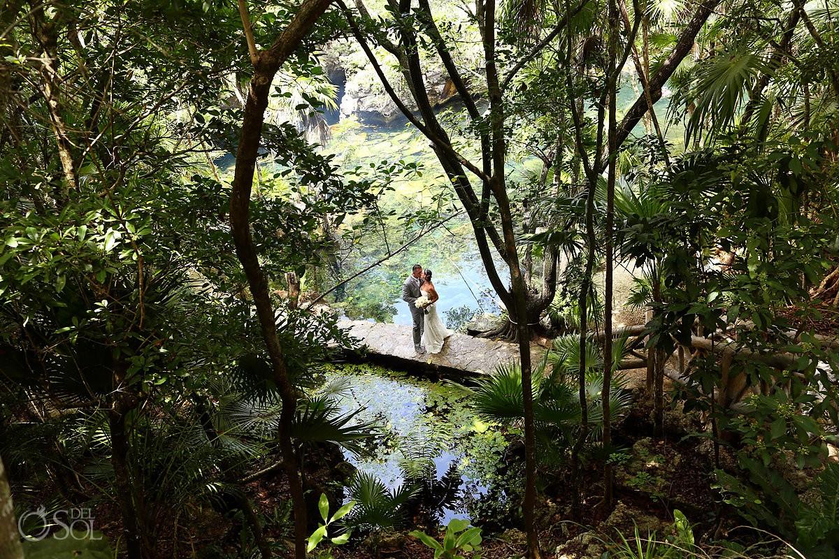 bride and groom jungle destination wedding portrait cenote trash the dress Riviera Maya Mexico